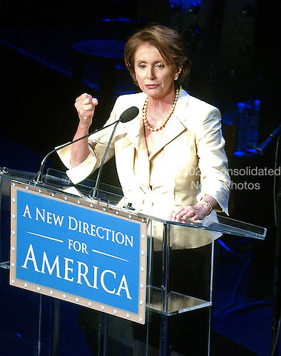 "Washington, D.C. - January 4, 2007 -- U.S. House Speaker Nancy Pelosi shakes her fist during her remarks at the ""Swearing-in Celebration Concert"" at the National Building Museum in Washington, D.C. on Thursday, January 4, 2007..Credit: Ron Sachs / CNP"