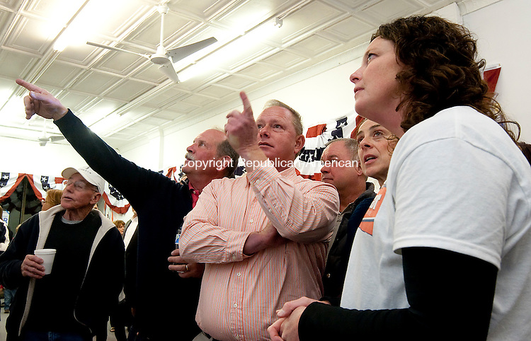 TORRINGTON,  CT-110816JS23- Todd Schaller, Republican challenger for the 65th House District, center, watches as restates come in with Dan Farley, left, and Laura Nietch, right, at Republican headquarters on Water Street in Torrington on Tuesday night. <br /> Jim Shannon Republican American
