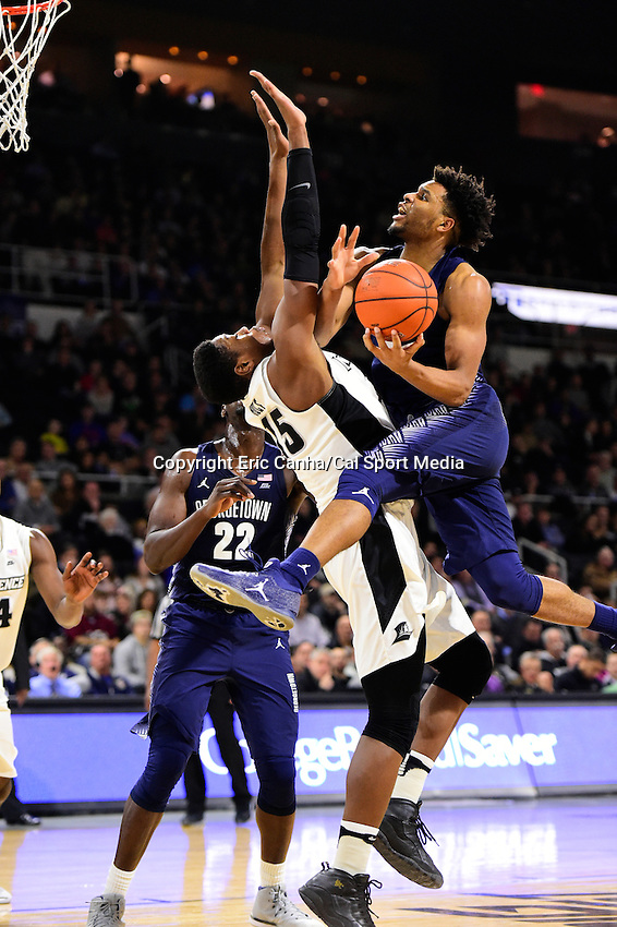 Wednesday, January 4, 2016: Providence Friars forward Emmitt Holt (15) blocks Georgetown Hoyas guard Jagan Mosely (4) on the way to the basket during the NCAA basketball game between the Georgetown Hoyas and the Providence Friars held at the Dunkin Donuts Center, in Providence, Rhode Island. Providence defeats Georgetown 76-70 in regulation time. Eric Canha/CSM