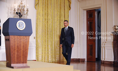 United States President Barack Obama arrives to deliver a statement on the situation regarding the Internal Revenue Service after meeting with Senior Treasury Officials, Wednesday, May 15, 2013 in the East Room of the White House in Washington, D.C..Credit: Olivier Douliery / Pool via CNP