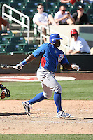 Michael Burgess of the Chicago Cubs plays against the Arizona Diamondbacks in a spring training game at Salt River Fields on March 13, 2011 in Scottsdale, Arizona. .Photo by:  Bill Mitchell/Four Seam Images.