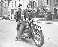 8TH aPRIL 1956. Forest Hill, London, ENGLAND;  John Surtees , international motorcyclist from Forest Hill, London was approached by men of the Royal Engineers today and asked for a ride on his pillion . This was part of their initiative test for selection for NCO. John Surtees is pictured with Sapper M Hume on pillion