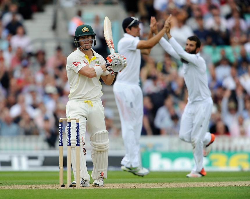 England's Moeen Ali (right) celebrates taking the wicket of Australia's David Warner caught by Adam Lyth for 85<br /> <br /> Photographer Ashley Western/CameraSport<br /> <br /> International Cricket - Investec Ashes Test Series 2015 - Fifth Test - England v Australia - Day 1 - Thursday 20th August 2015 - Kennington Oval - London<br /> <br /> &copy; CameraSport - 43 Linden Ave. Countesthorpe. Leicester. England. LE8 5PG - Tel: +44 (0) 116 277 4147 - admin@camerasport.com - www.camerasport.com