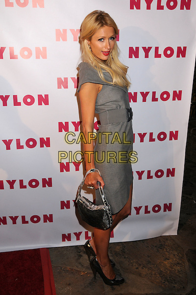"PARIS HILTON.NYLON Magazine's ""90210"" Cover Launch Party at the Roosevelt Hotel's Tropicana Bar, Hollywood, California, USA..September 4th, 2008.full length grey gray dress belt metallic shoes silver bag purse .CAP/ADM/BP.©Byron Purvis/AdMedia/Capital Pictures."