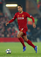 5th November 2019; Anfield, Liverpool, Merseyside, England; UEFA Champions League Football, Liverpool versus Genk; Virgil van Dijk of Liverpool brings the ball out of defence - Editorial Use