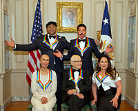 The five recipients of the 40th Annual Kennedy Center Honors pose for a group photo following a dinner hosted by United States Secretary of State Rex Tillerson in their honor at the US Department of State in Washington, D.C. on Saturday, December 2, 2017.  From left to right back row: LL Cool J and Lionel Richie  Front row, left to right: Carmen de Lavallade, Norman Lear and Gloria Estefan.  The 2017 honorees are: American dancer and choreographer Carmen de Lavallade; Cuban American singer-songwriter and actress Gloria Estefan; American hip hop artist and entertainment icon LL COOL J; American television writer and producer Norman Lear; and American musician and record producer Lionel Richie. Photo Credit: Ron Sachs/CNP/AdMedia