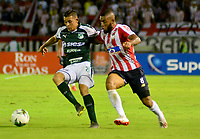 BARRANQUILLA-COLOMBIA, 02-06-2019: Fredy Hinestroza de Atlético Junior y Carlos Rodríguez de Deportivo Cali disputan el balón, durante partido entre Atlético Junior y Deportivo Cali, de la fecha 5 de los cuadrangulares semifinales por la Liga Águila I 2019,  jugado en el estadio Metropolitano Roberto Meléndez de la ciudad de Barranquilla. / Fredy Hinestroza of Atletico Junior and Carlos Rodriguez of Deportivo Cali figth for the ball, during a match between Atletico Junior and Deportivo Cali, of the 5th date of the semifinals quarters for the Aguila Leguaje I 2019  played at the Metropolitano Roberto Melendez Stadium in Barranquilla city, Photo: VizzorImage / Alfonso Cervantes / Cont.