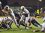 Torrance, CA 09/25/15 - Griffin Martes (El Segundo #27) and Taz Tauaese (El Segundo #4) in action during the El Segundo - Torrance varsity football game at Zamperini Field of Torrance High School