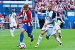 "Atletico de Madrid's player Antoine Griezmann and Deportivo de la Coruña's players Guilherme Dos Santos and Luis ""Luisinho"" Carlos Correia during a match of La Liga Santander at Vicente Calderon Stadium in Madrid. September 25, Spain. 2016. (ALTERPHOTOS/BorjaB.Hojas)"