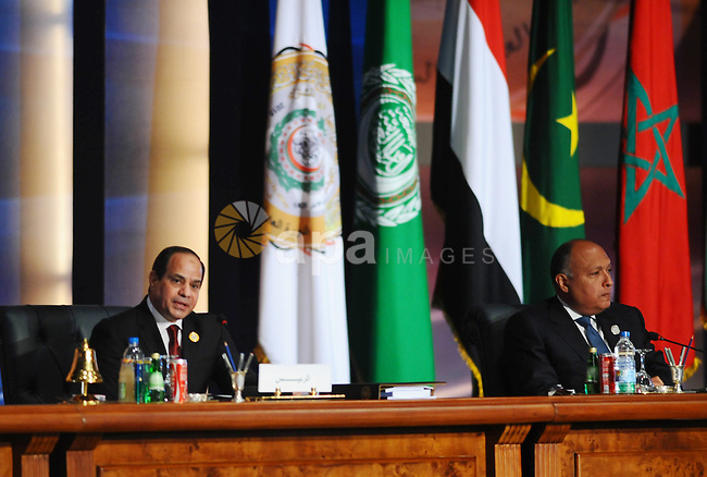 """A handout picture made available by the Egyptian presidency shows Egyptian President Abdel Fattah al-Sisi give a speech during the opening meeting of the Arab Summit in Sharm el-Sheikh, in the South Sinai governorate, south of Cairo, March 28, 2015. Sisi told an Arab League summit on Saturday that Cairo backed calls for a unified Arab force to confront regional security threats. Sisi also said Egypt's participation in a military campaign against Shi'ite Houthi militias in Yemen, which has been led by Saudi Arabia, aimed to """"preserve Yemen's unity and the peace of its territories."""" . Egyptian Presidency"""