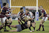 Nigel Watson tries to break out of the tackle of Jeff Wright during the Air NZ Cup game between the Counties Manukau Steelers and Southland played at Mt Smart Stadium on 3rd September 2006. Counties Manukau won 29 - 8.