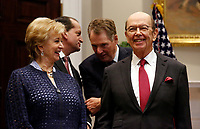 United States Secretary of Commerce Wilbur L. Ross, Jr. (right) and Administrator of the Small Business Administration Linda E. McMahon share a laugh prior to President Donald J. Trump announcing David Malpass as his choice to lead the World Bank, in the Roosevelt Room of the White House, Washington, DC, February 6, 2019. Also shown are US Trade Representative Robert Lighthizer (behind, right) and US Secretary of Labor Alex Acosta. Photo Credit: Martin H. Simon / CNP/AdMedia