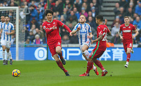 Huddersfield Town's Alex Pritchard is fouled by Swansea City's Kyle Naughton<br /> <br /> Photographer Alex Dodd/CameraSport<br /> <br /> The Premier League - Huddersfield Town v Swansea City - Saturday 10th March 2018 - John Smith's Stadium - Huddersfield<br /> <br /> World Copyright &copy; 2018 CameraSport. All rights reserved. 43 Linden Ave. Countesthorpe. Leicester. England. LE8 5PG - Tel: +44 (0) 116 277 4147 - admin@camerasport.com - www.camerasport.com