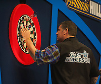 04.01.2015.  London, England.  William Hill PDC World Darts Championship.  Finals Night.  Gary Anderson (4) [SCO] takes a good look at a finish during his game against Phil Taylor (2) [ENG].