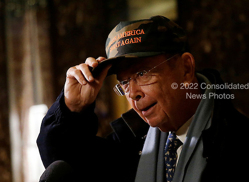 Billionaire investor Wilbur Ross speaks to reporters in the lobby of Trump Tower on November 29, 2016 in New York City. U.S. President-elect Donald Trump is still holding meetings upstairs at Trump Tower as he continues to fill in key positions in his new administration.   <br /> Credit: John Angelillo / Pool via CNP