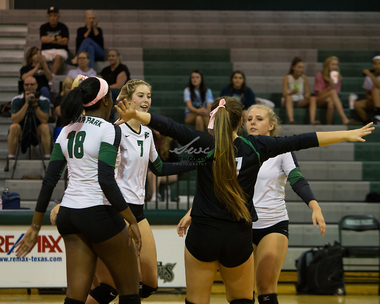 The Cedar Park Timberwolves celebrate a point during the high school volleyball game between Cedar Park and Elgin at Cedar Park High School in Cedar Park, Texas, on October 3, 2017.