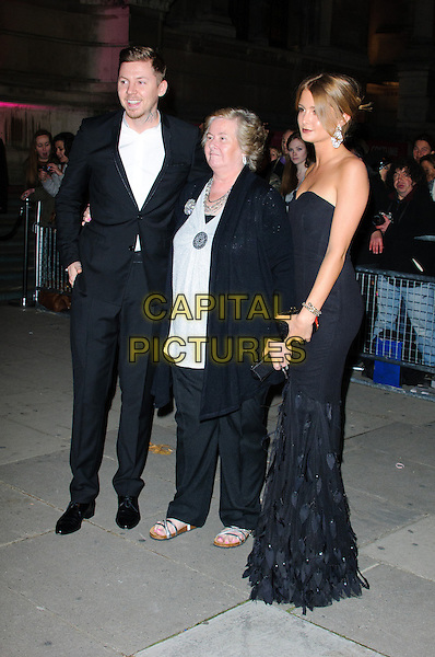 Nana Patricia Patricia Brooker aka Nanny Pat, Professor Green (Stephen Paul Manderson) & Millie Mackintosh.Cosmopolitan Ultimate Women Of The Year Awards held at the Victoria and Albert Museum (V&A), London, England..October 30th, 2012.full length black jacket white top suit strapless dress couple side feathers .CAP/CJ.©Chris Joseph/Capital Pictures.