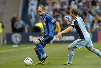 KANSAS CITY, KS - June 1, 2013:<br /> Justin Mapp  (21)midfield Montreal Impact watched by Seth Sinovic (15) defender Sporting KC <br /> Montreal Impact defeated Sporting Kans.as City 2-1 at Sporting Park.