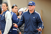 11 February 2012:  FIU Head Coach Jake Schumann reacts to a call as the University of Massachusetts Minutewomen defeated the FIU Golden Panthers, 3-1, as part of the COMBAT Classic Tournament at the FIU Softball Complex in Miami, Florida.