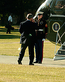 United States President George W. Bush salutes the Marine guard as he boards Marine One at the Naval Observatory in Washington, DC en route to Andrews Air Force Base for a campaign trip to the West Coast on June 16, 2006.<br /> Credit: Ron Sachs - Pool via CNP