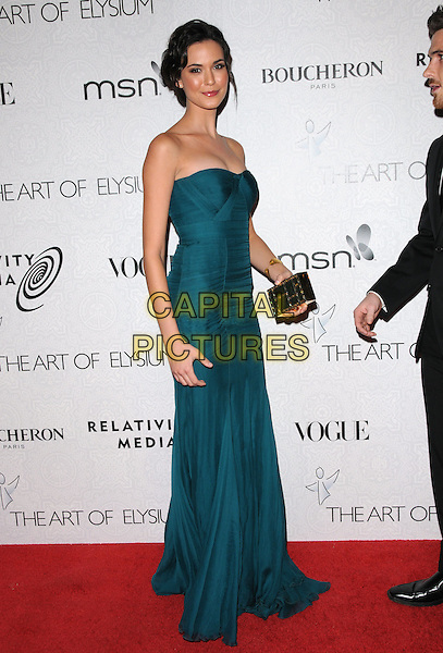 "ODETTE YUSTMAN.Art of Elysium 3rd Annual Black Tie charity gala '""Heaven"" held at 990 Wilshire Blvd in Beverly Hills, California, USA, .January 16th 2010 .full length blue green teal strapless maxi dress black clutch bag.CAP/RKE/DVS .©DVS/RockinExposures/Capital Pictures"