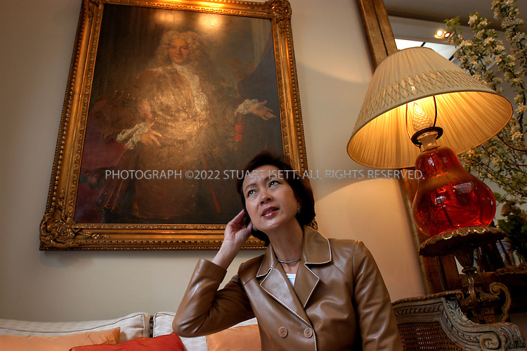 5/4/2004--Paris, France..Grace Leo-Andrieu, the Hong Kong-Chinese owner of the Lancaster Hotel in Paris and president of G.L.A. International which owns a line of boutique hotels across Europe. Photographed at the Lancaster Hotel in Paris...Photograpgh by Stuart Isett.©2004 Stuart Isett. All rights reserved