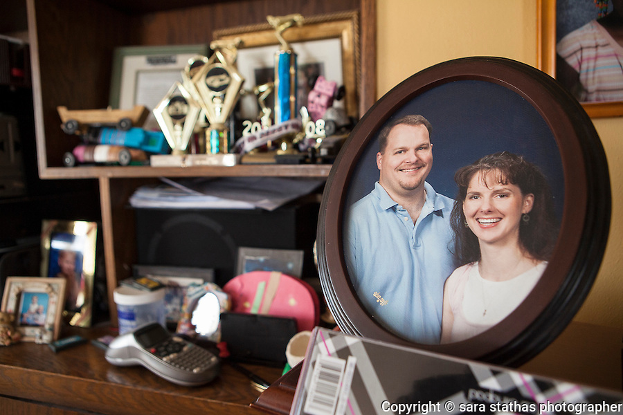 A framed photo of Todd and Melissa Puchalla sits on top of the piano in their Kiel, Wisconsin home.  Melissa and her husband, Todd, rehomed their adopted daughter Quita, from Liberia, when she was 15 years old to Nicole and Calvin Eason. REUTERS/Sara Stathas (UNITED STATES)