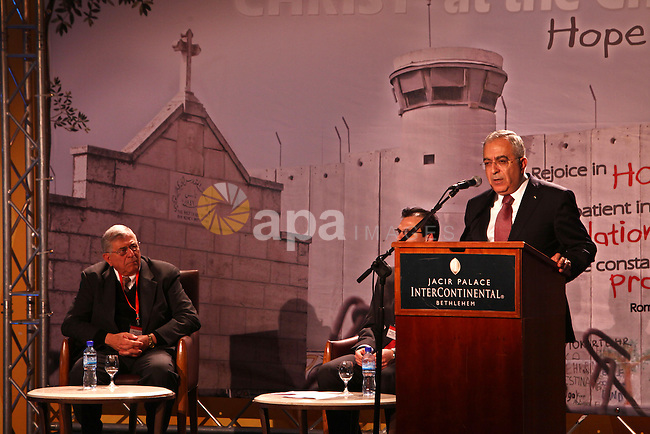 Palestinian Prime Minister, Salam Fayyad, speaks during the world christian conference in the West Bank city of Bethlehem, on Mar. 05, 2012. Photo by Mustafa Abu Dayeh