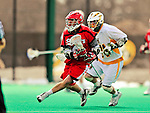 19 March 2011: St. John's University Red Storm Midfielder Jordan Rothman, a Sophomore from Bridgewater, NJ, keeps one step ahead of UVM's Tom Frasca during action against the University of Vermont Catamounts at Moulton Winder Field in Burlington, Vermont. The Catamounts defeated the visiting Red Storm 14-9. Mandatory Credit: Ed Wolfstein Photo