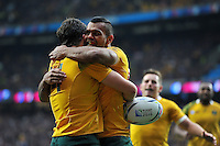 Adam Ashley-Cooper of Australia is congratulated on his try by team-mate Kurtley Beale but the score is later ruled out. Rugby World Cup Quarter Final between Australia and Scotland on October 18, 2015 at Twickenham Stadium in London, England. Photo by: Patrick Khachfe / Onside Images