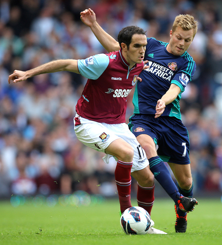 West Ham United's Joey O'Brien battles with Sunderland's Sebastian Larsson ..Football - Barclays Premiership - West Ham United v Sunderland - Saturday 22nd September 2012 - Boleyn Ground - London..