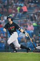 Anthony Villa (37) of the Great Falls Voyagers follows through on his swing against the Helena Brewers at Centene Stadium on August 18, 2017 in Helena, Montana.  The Voyagers defeated the Brewers 10-7.  (Brian Westerholt/Four Seam Images)