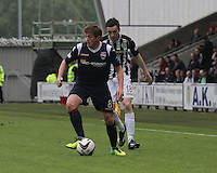 Richie Brittain being closed down by Sean Kelly in the St Mirren v Ross County Scottish Professional Football League Premiership match played at St Mirren Park, Paisley on 3.5.14.