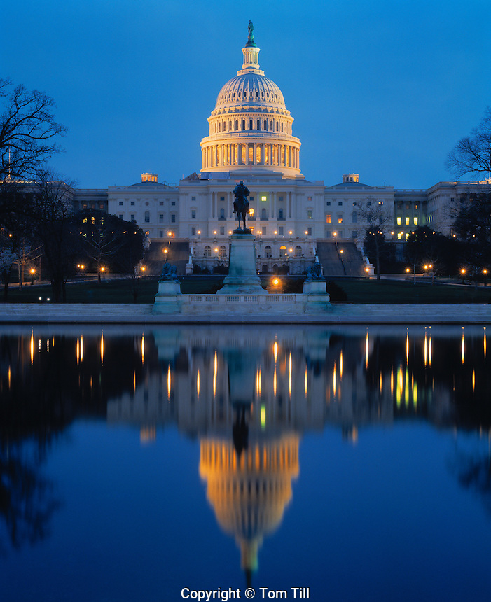 United States Capitol, Washington, D.C.  Reflected in Ca[itol reflecting pool on National Mall