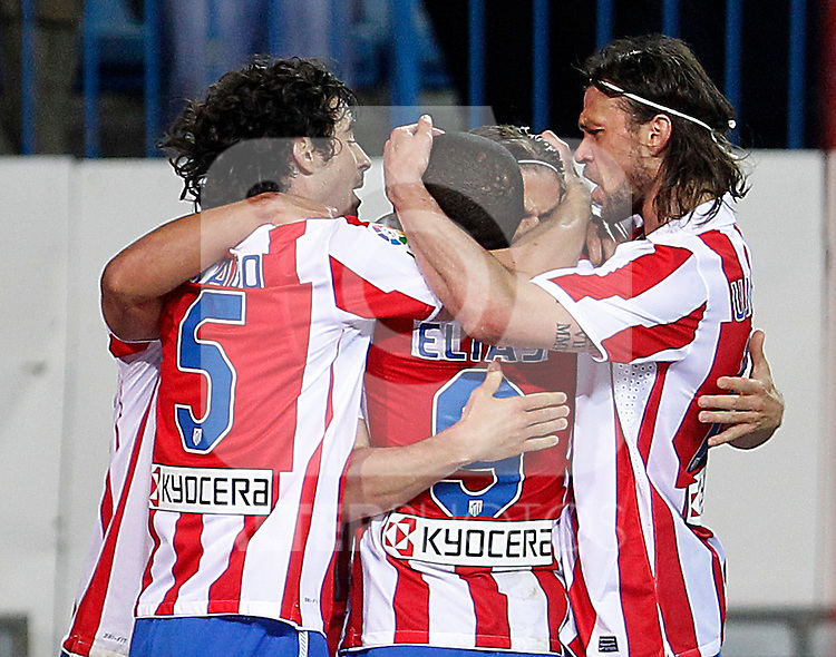 Atletico de Madrid's Tiago Cardoso, Elias, Filipe Luis and Tomas Ujfalusi celebrate goal during La Liga match.March 5,2011. (ALTERPHOTOS/Acero)