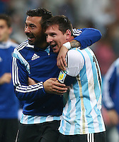 Ezequiel Lavezzi and Lionel Messi of Argentina celebrate after winning the penalty shootout