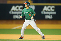 Stephen Perez #4of the Miami Hurricanes takes his lead off of second base against the Wake Forest Demon Deacons at Gene Hooks Field on March 18, 2011 in Winston-Salem, North Carolina.  Photo by Brian Westerholt / Four Seam Images