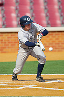 Andy Lentz #7 of the Georgetown Hoyas bunts the ball against the Delaware State Hornets at Gene Hooks Field on February 26, 2011 in Winston-Salem, North Carolina.  Photo by Brian Westerholt / Four Seam Images