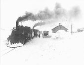 D&amp;RGW #476 with freight train at Silverton depot; bulldozer nearby.<br /> D&amp;RGW  Silverton, CO  Taken by Norwood, John B. - 1940-1949