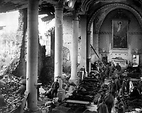 This shattered church in the ruins of Neuvilly furnished a temporary shelter for American wounded being treated by the 110th Sanitary Train, 4th Ambulance Corps.  France, September 20, 1918. Sgt. J. A. Marshall. (Army)<br /> NARA FILE #:  111-SC-24942<br /> WAR & CONFLICT BOOK #:  667
