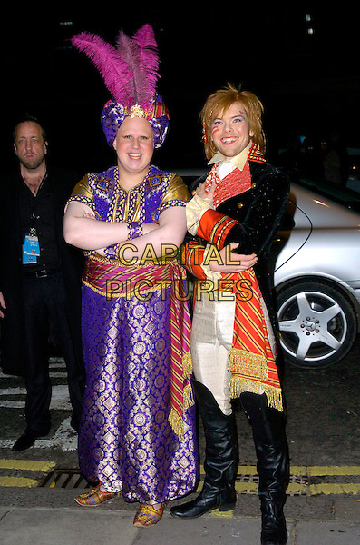MATT LUCAS & KEVIN McGEE .At their fancy dress party reception following their civil partnership ceremony (wedding) earlier the same day, Banquetting House, Whitehall, London, England, .17th December 2006. .full length funny costumes arms folded pose adm ant style indian turban feather purple gold red black boots make-up.CAP/CAN.©Can Nguyen/Capital Pictures