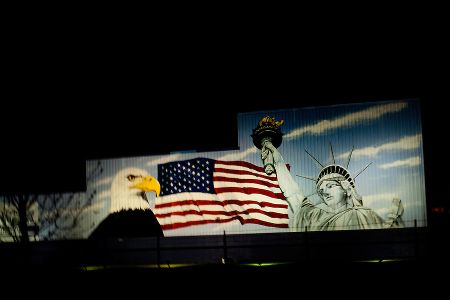 Erie, Pennsylvania, April 11, 2010 - A view mural on the side of building showing a bald eagle, the American flag and the Statue of Liberty seen from a Tea Party Express bus after a rally in Perry Square. The 7,000 plus mile tour across 20 states focused on towns and communities wear the Tea Party has traction. .