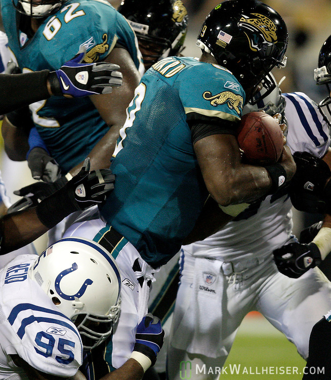Jacksonville Jaguars quarterback David Garrard scores on a short scramble in the first half of their NFL football game against the Indianapolis Colts in Jacksonville, Florida December 18, 2008.  (Mark Wallheiser/TallahasseeStock.com)