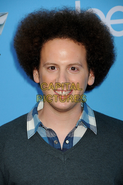 "JOSH SUSSMAN .""Glee"" Season Two Premiere and DVD Release Party held at Paramount Studios,  Los Angeles, California, USA, 7th September 2010 .portrait headshot smiling afro hair grey gray jumper sweater blue plaid checked check shirt .CAP/ADM/BP.©Byron Purvis/AdMedia/Capital Pictures."