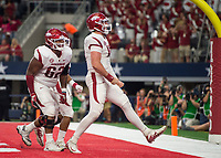 Hawgs Illustrated/Ben Goff<br /> Johnny Gibson (62), Arkansas right guard, and Cole Kelley, Arkansas quarterback, celebrate after Kelley ran in a touchdown in the 2nd quarter vs Texas A&M Saturday, Sept. 29, 2018, during the Southwest Classic at AT&T Stadium in Arlington, Texas.