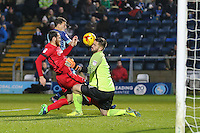 Scott Kashket of Wycombe Wanderers shoots goal wards only for Goalkeeper Alex Cisak of Leyton Orient (1) to save with his head during the Sky Bet League 2 match between Wycombe Wanderers and Leyton Orient at Adams Park, High Wycombe, England on 17 December 2016. Photo by David Horn / PRiME Media Images.
