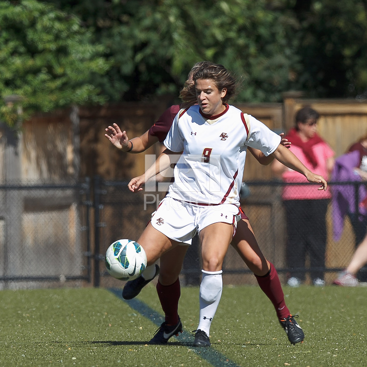 Tightly defended Boston College forward Stephanie McCaffrey (9) passes the ball. Virginia Tech (maroon) defeated Boston College (white), 1-0, at Newton Soccer Field, on September 22, 2013.