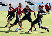 Head coach Ben OLsen and assistant Chad Ashton with Ethan White#15 and Conor Shanosky#17 of D.C. United during a training session in Hapgood Stadium on the campus of the Citadel,on March 11 2011, in Charleston, South Carolina