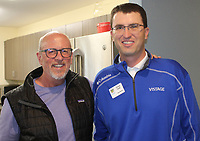 Steve Collins (left) and Chuck Hyde visit at the Children's Advocacy Center of Benton County.<br /> (NWA Democrat-Gazette/Carin Schoppmeyer)