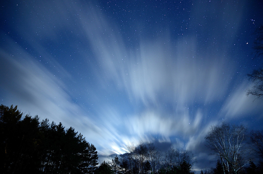 A long exposure shot of fast moving clouds passing through the sky while the moon is rising. Marquette County, Michigan.